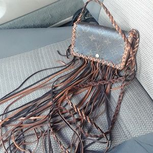 Fringed Louis Vuitton wallet handbag